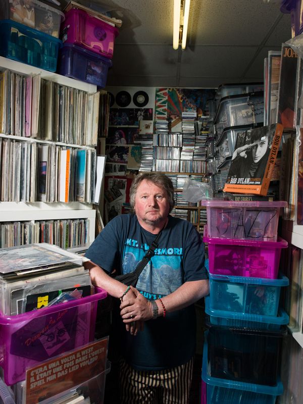 Dougie McShane, Backbeat Records Southsiders: Portrait of a Community is an artistic project by Peter Dibdin using both photography and audio, in print and online to celebrate and explore perceptions around the identity of the Southside community of Edinburgh, Scotland. Thirty-eight people who live, work or have a connection to the city's Southside area have generously given their time to be photographed by Edinburgh based photographer Peter Dibdin in locations holding a special significance for them. Each participant has also recorded the audio story behind their portrait to uncover the moving, inspirational and significant contribution the Southside makes to the history and heritage of Edinburgh. All 32 portraits and their audio narratives can be viewed at http://www.edinburghsouthsiders.co.uk