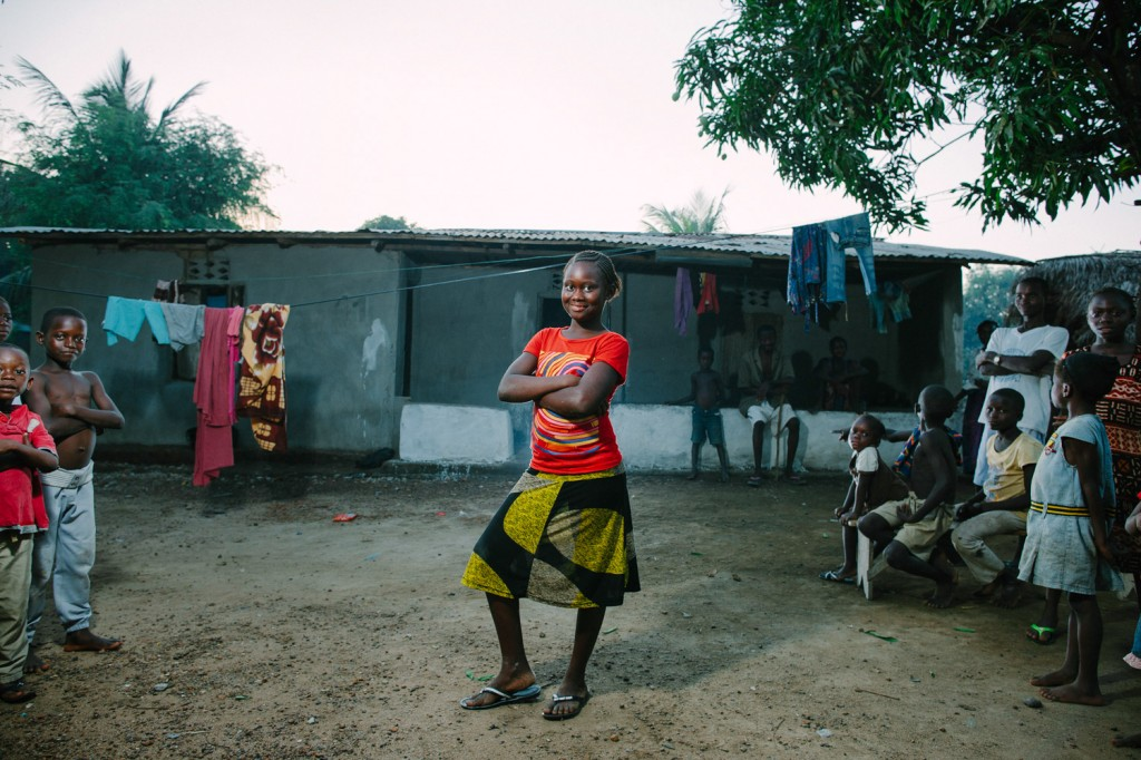 One of the Swawou School students Gbishi Brama infront of her home she shares with her own and 3 other families.