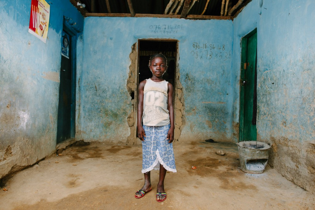 One of the Swawou School students Aminata Sheriff infront of her home.
