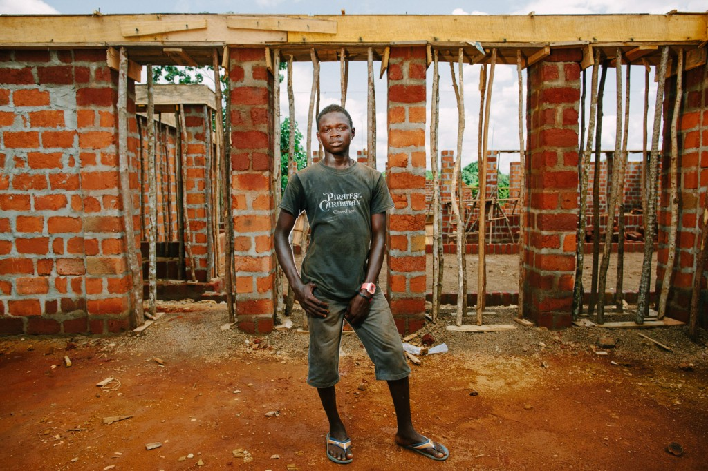 Labourer Mustapha Vibbie on the Swawou school building site. Mustapha is working to be able to afford to go back to school.