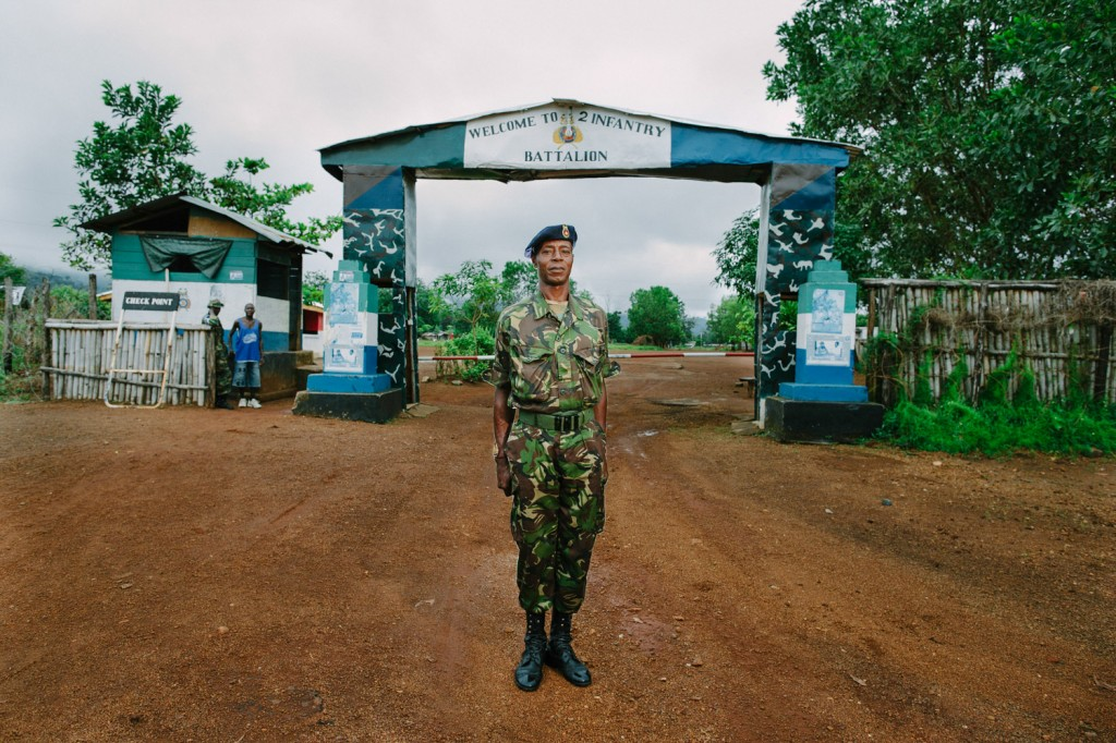 RSM Kamara, 2nd Infantry Battalion in front of the barracks gates. The barracks is right next to the new Swawou school providing support and protection to the build and the building.