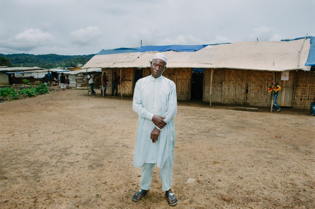 Chief Ansumana Sheriff in front of the old Swawou school. He is Chief for the area IDA area of Kenema.