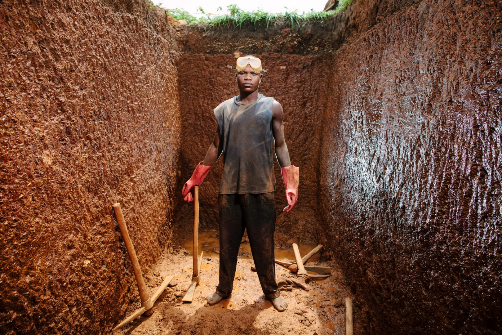 Moina Kallon AKA Jagga, labourer, Jagga and a couple of other guys dug a fifteen foot cesspit in the heat.