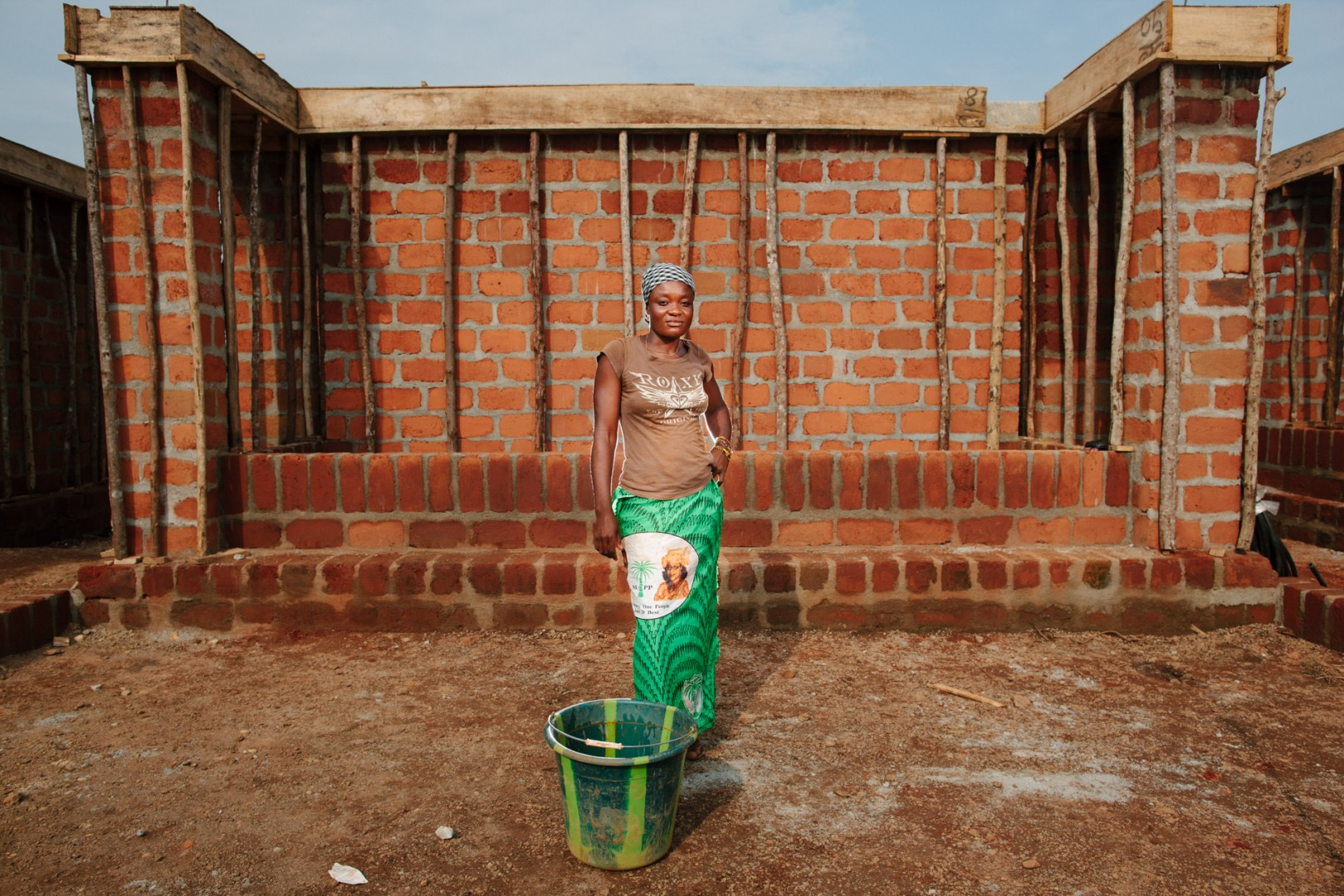 Lucia Sam, brick cleaner. Because the bricks where no being plastered Lucia kept them clean from all the dust and muck of the work.