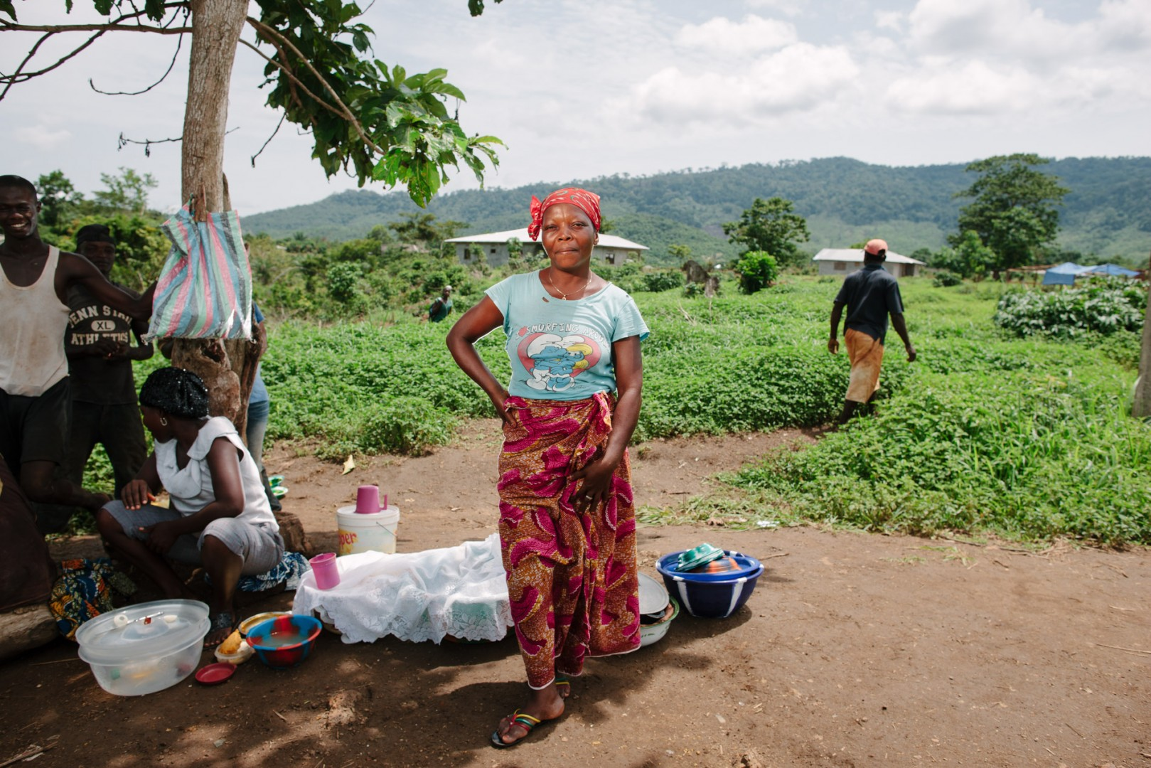 Agnes, cook. Agnes setup a small kitchen under the tree next to the building site selling lunch to all the workers.