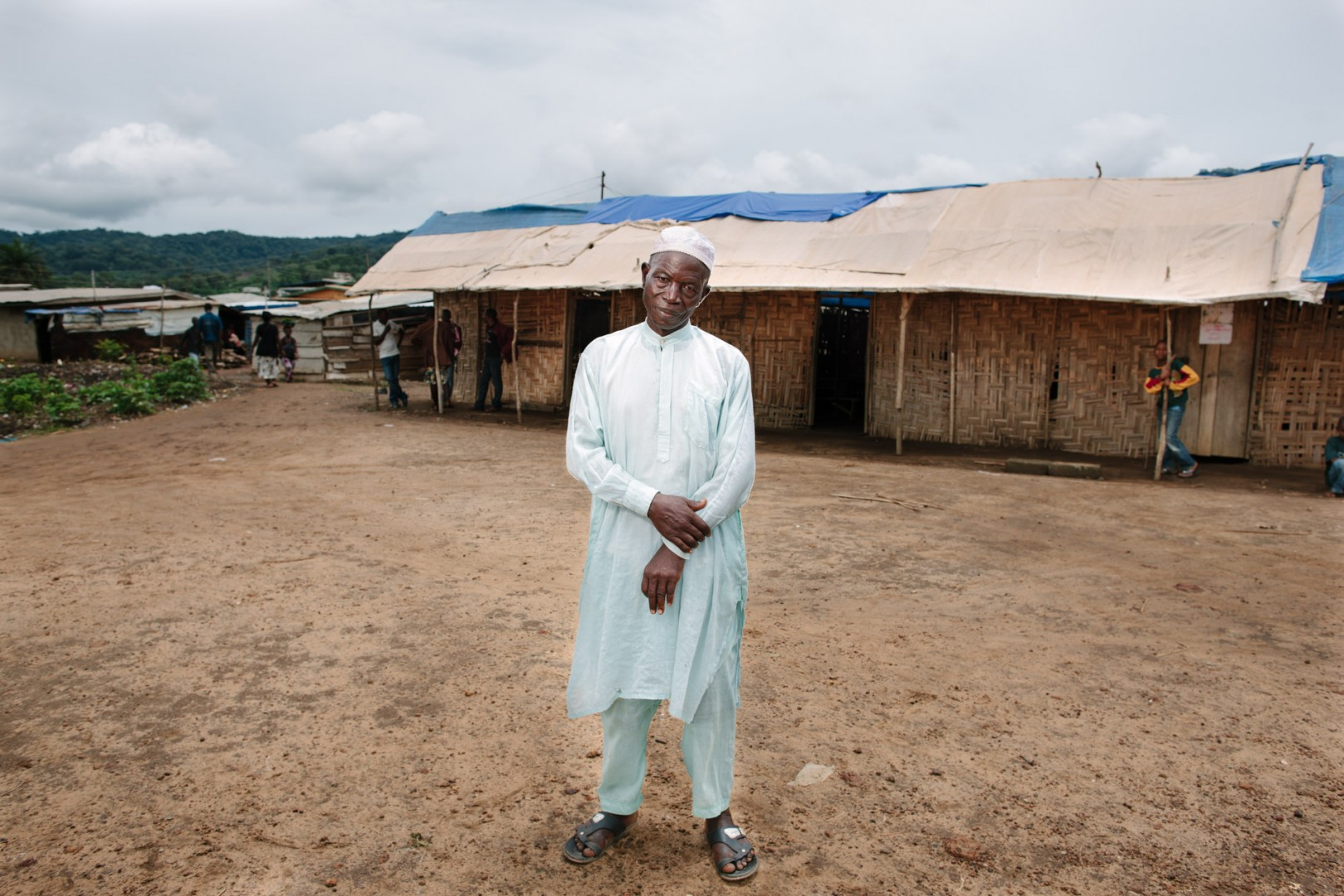 Chief Ansumana Sheriff, Chief of the area where the current Swawou school is, which can be seen in the background.
